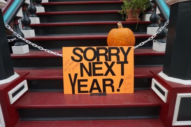 doorstep sign saying sorry next year